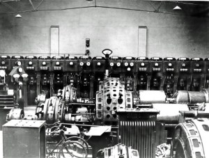 SWEHS 17.0.038.jpg - Date 1936 - St James Street generating station 11kV 150MVA 17 panel made by Crompton with 1, 2, and 3 2.2kV alternators in foreground. Synchronisation panel on left of photograph. Somerset, Taunton .