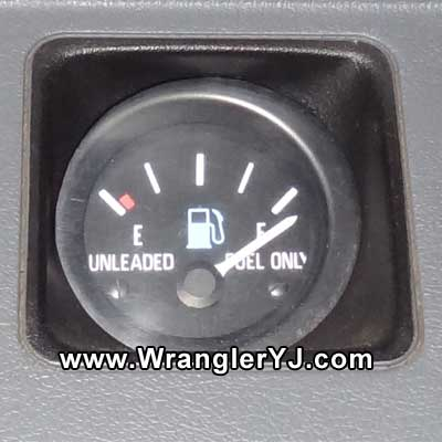 FULL tank with the engine running.