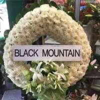พวงหรีดดอกไม้สด BLACK MOUNTAIN ณ วัดโสมนัสวิหาร