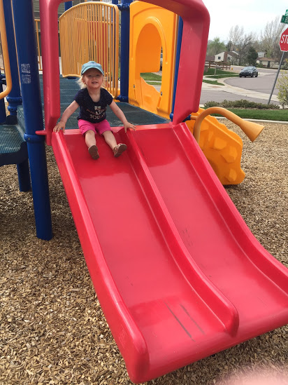 Zoey on the slide at the playground