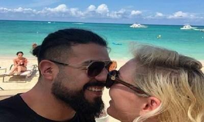 Andrade and Charlotte Flair