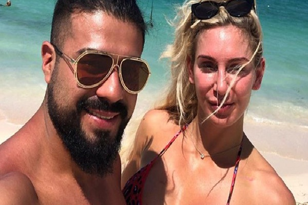 WWE Charlotte Flair And Andrade May Be Engaged