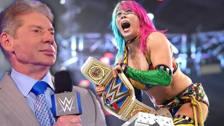 Asuka and Vince McMahon