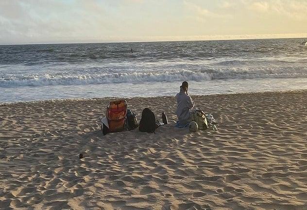 Siliana Gaspard remained on the beach Sunday evening