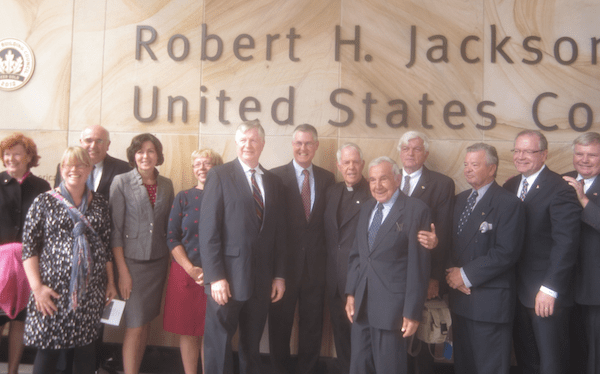 Standing in front of the Robert H. Jackson United States Courthouse in Buffalo, (From L-R): Peggy Morgan, Jennifer Champ, James C. Johnson, Deb Pacos, Carol Drake, Tom Loftus, John Barrett, Father Moritz Fuchs, Honorable Joseph Gerace, Doug Neckers, John Anderson, Randy Sweeney, Greg Peterson (Photo courtesy of Jackson Center)