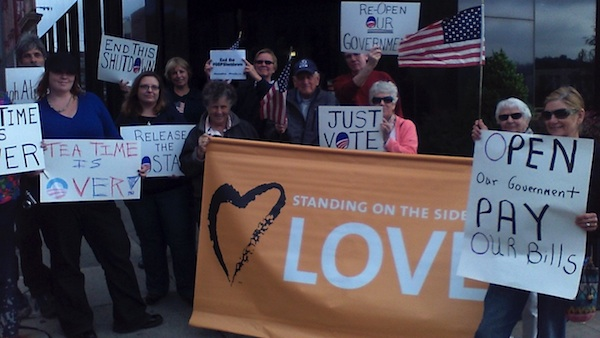 About 20 residents were in downtown Jamestown on Tuesday protesting the government shutdown in front of Congressman Tom Reed's office. (Photo by Jason Sample/WRFA)