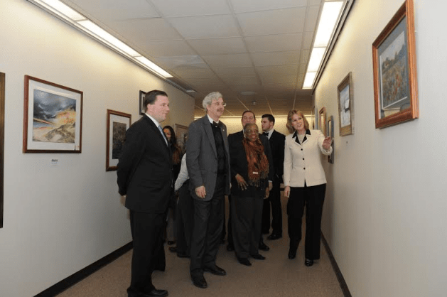 Assembly members Tom McKevitt, Andy Goodell, Barbara Clark, and Ray Walter join Senator Cathy Young and others to admire artwork created by members of Women Create from Chautauqua County.  (Image from Andrew Goodell)
