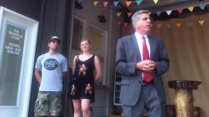 Jamestown Mayor Sam Teresi talks with the crowd that gathered for the grand opening of The Sprinkle Cone ice cream parlor, as owner Kate Harris and building owner Pete Schiera look on.