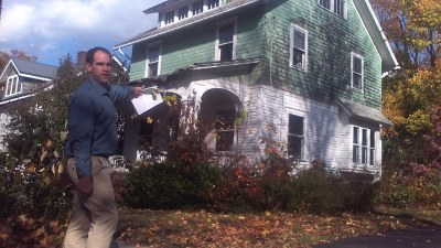State Assembly Candidate Barrie Yochim of Jamestown Stands in front of a 'zombie property' on Weeks St. in Jamestown. Yochim said that unlike his opponent Andy Goodell, if elected he would support a measure that addresses the growing problem of zombie properties in New York State.