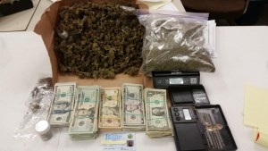 Cash and marijuana that was recovered during a drug raid Friday, Jan. 16, 2015 in Jamestown.