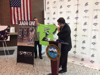 Jammers officials reveal the team T-shirt, several of which were given away to attendees of the press conference and will also be for sale throughout the 2015 season.