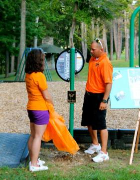 The parents of Kallie Swan, Tara and Shane, help to unveil a memorial plaque and swing set in Kallie's honor on Aug. 11, 2015.