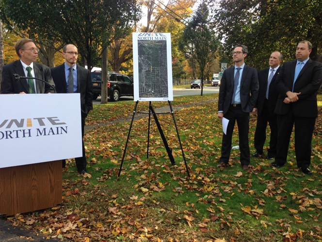 Greg Lindquist and Peter Lombardi of the Jamestown Renaissance Corporation provide details of the 'Unite North Main' project as Joe Rollman from Clark Paterson Lee, Jim Domagola of  Northwest Savings Bank, and Brian Kulpa of Clark Patterson Lee look on.
