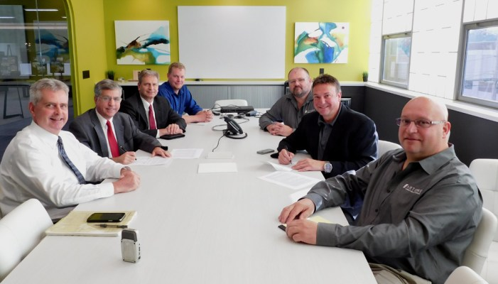 Pictured signing a Flex Rate agreement are: (left, front to back:  BPU General Manager David Leathers, Jamestown City Mayor/BPU Board President Sam Teresi, BPU Board Chair John Zabrodsky and BPU Energy Efficiency Coordinator Dan Reynolds.  (right, front to back:  Artone  Vice President Sebastian Calimeri, Artone President Michael Calimeri and Jim Tharp, Artone Facilities Manager.