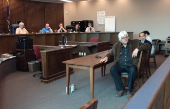 Lynn Development Group founder Gary Lynn (foreground) and board member listens while members of the public address Jamestown Zoning Board of Appeals during its May 4, 2016 meeting.
