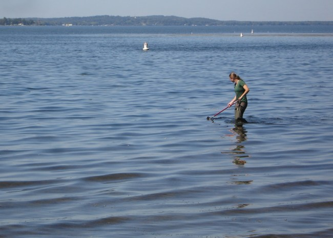 Jen Maguder, Conservationist with the Chautauqua Watershed Conservancy, collects a water sample from near the beach at Long Point State Park on Chautauqua Lake in Bemus Point, New York. Ms. Maguder and Randall Perry (not pictured), Project Manager with the Chautauqua Lake & Watershed Management Alliance, also collected a sample from the lake's South Basin in Celoron as part of an international study on microplastics in inland lakes