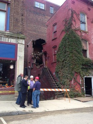 City officials discuss how to proceed with the demo of a building at 10-12 E. Second St. in Jamestown following a roof collapse on Thursday, Oct. 20, 2016.