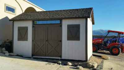 orchard shed with fake shutters