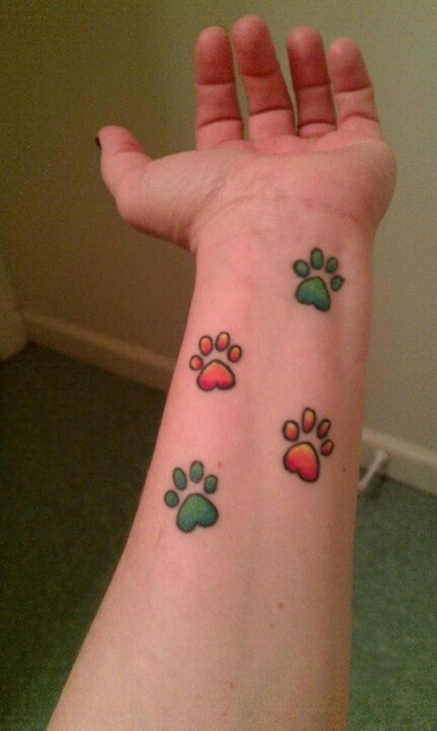 Small Dog Paw Print Tattoo On Wrist