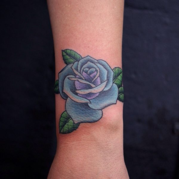 Blue Rose Tattoo On Black Skin