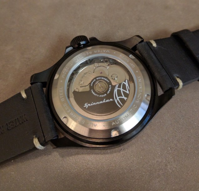 It's a Seiko, but Spinnaker doesn't say which one. Probably a 4R35, which hacks and hand winds.