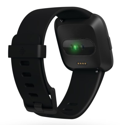 Product render of Fitbit Versa in back view in classic black showing sensor glow
