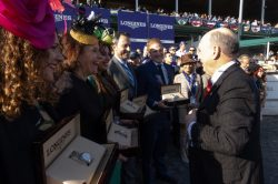 Presenting Longines Conquest VHP watches to the winners of the Breeders Cup Distaff race.