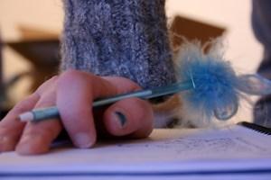Writing the three words.