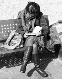 Woman reading a book.