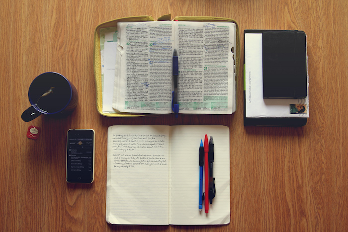 Daily devotions: Bible, journal, and pens.