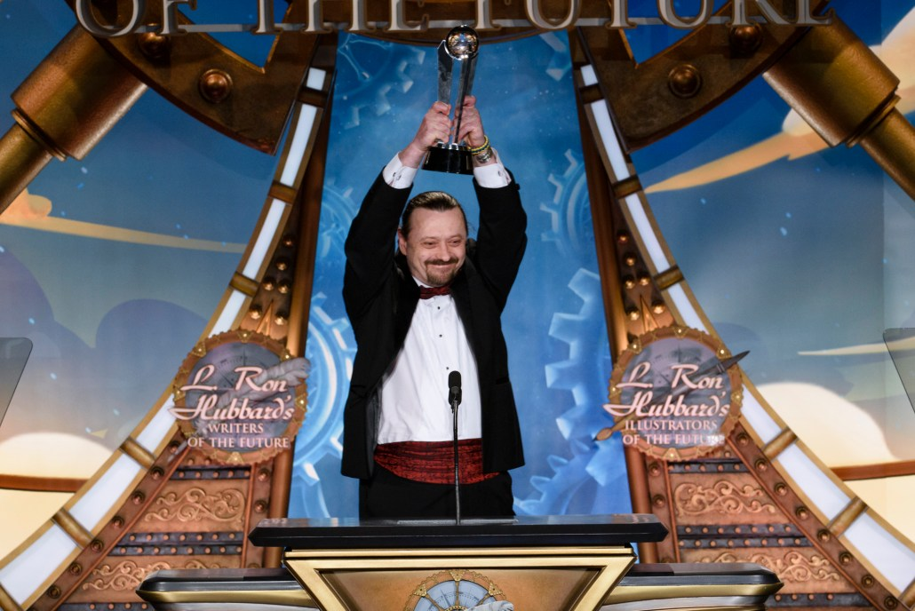 Sergey Poyarkov receiving his L. Ron Hubbard Silver Star Award.