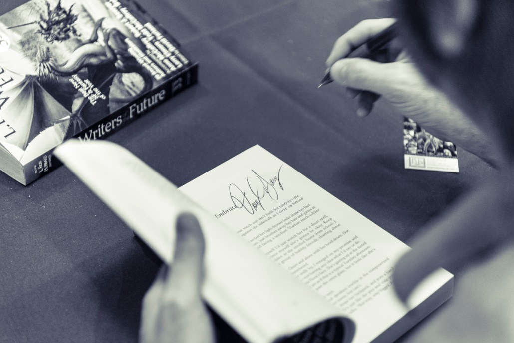 Doug Souza autographing his story in Writers of the Future Volume 33