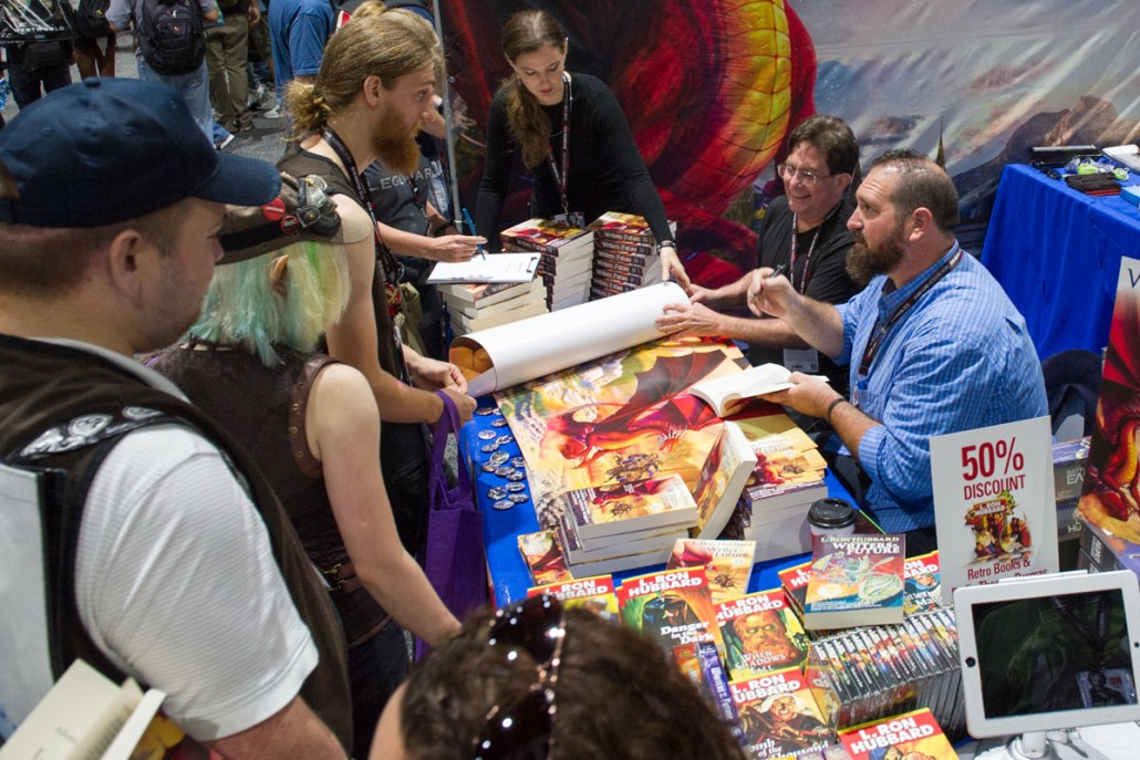 Andrew and Jake signing books for fans at SDCC.