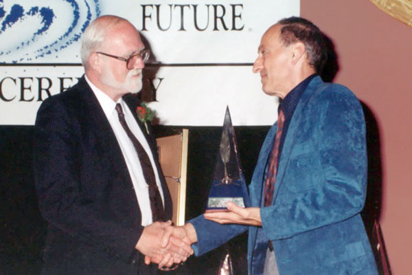 James C. Glass receives his First Place trophy from Roger Zelazny.