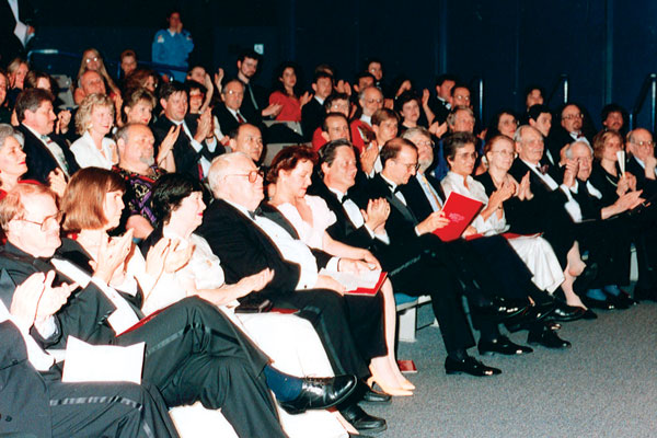 The audience applauds in the Destiny Theater.