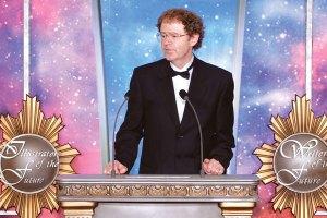 Brian Herbert presents an award
