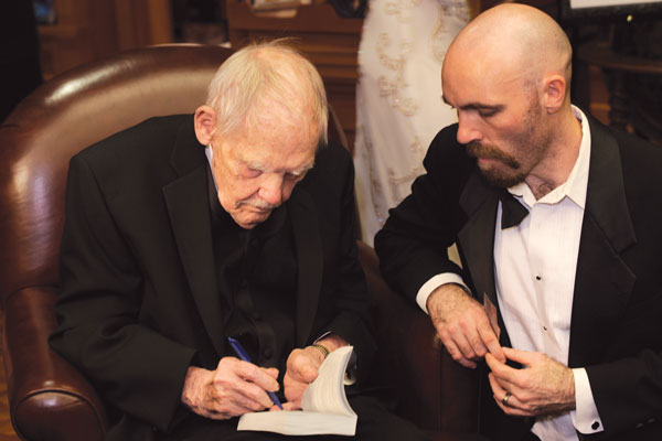 Gold Pen award-winner Ian McHugh gets his book signed.