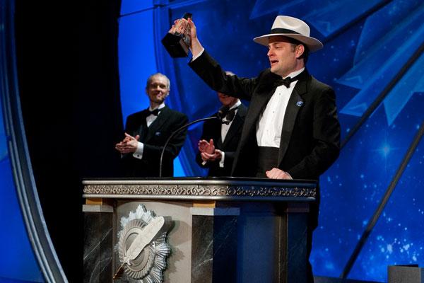 Writer winner Ryan Harvey on stage.