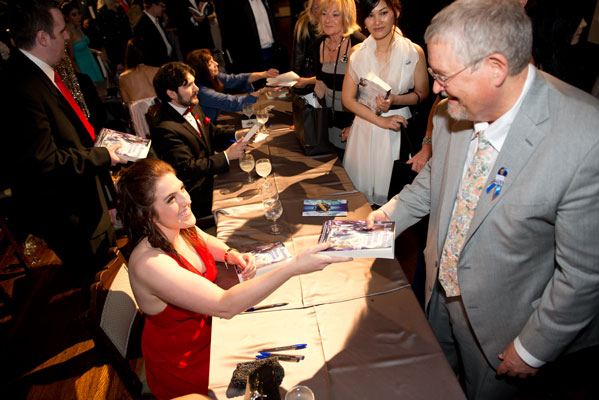 Writer winner Shauna O'Meara signs her story for Orson Scott Card.