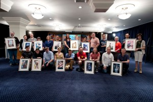 Group shot of the artists with their illustration and the authors to the stories.