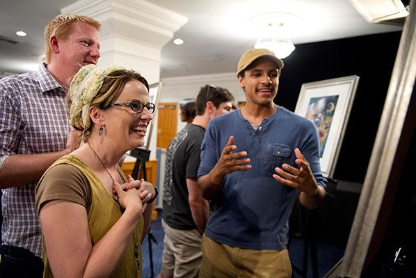 Author Amy Hughes (left) and husband with artist Taylor Payton who did the illustration for her story.