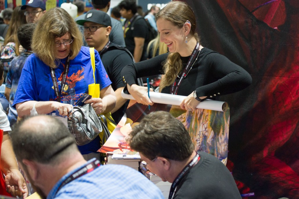 Emily helping with the posters during the signing.