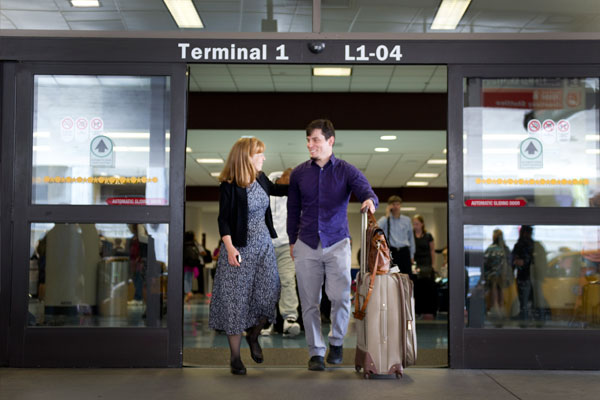 Joann greeting Zach Chapman at the airport