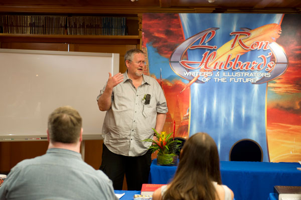 Writer judge and author Orson Scott Card speaks to the writer winners.