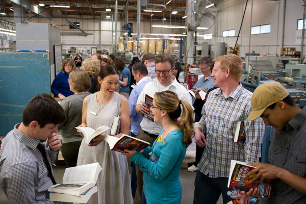 The writers and illustrators at Bang Printing in Valencia see their completed book hot off the press!