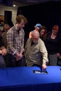 Larry Elmore reviewing Paul Otteni's porfolio.