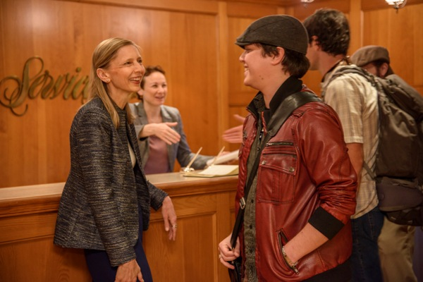 Ryan Row being greeted by Gunhild Jacobs, Executive Director Author Services.