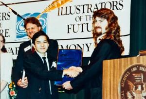 Illustrator judge Bob Eggleton presenting Shaun Tan with his award.