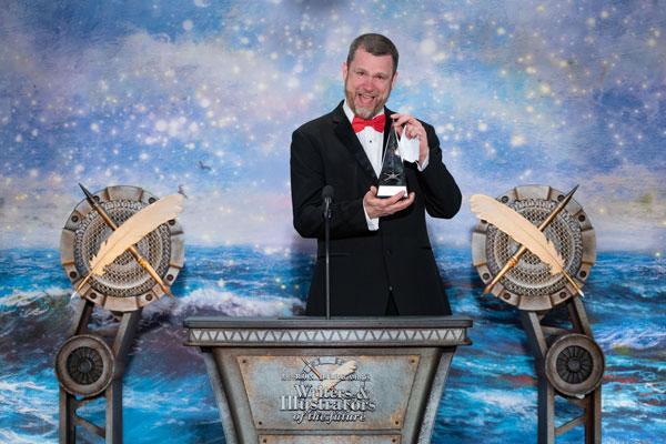 John accepting his award