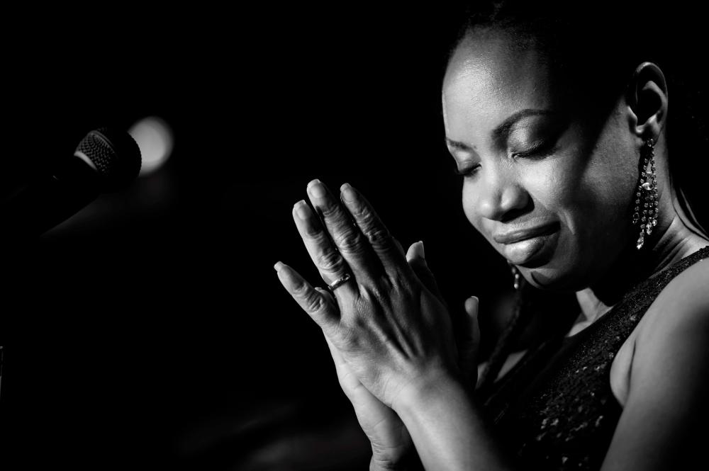 Award-winning singer-songwriter hailing from Dominica, Michele Henderson
